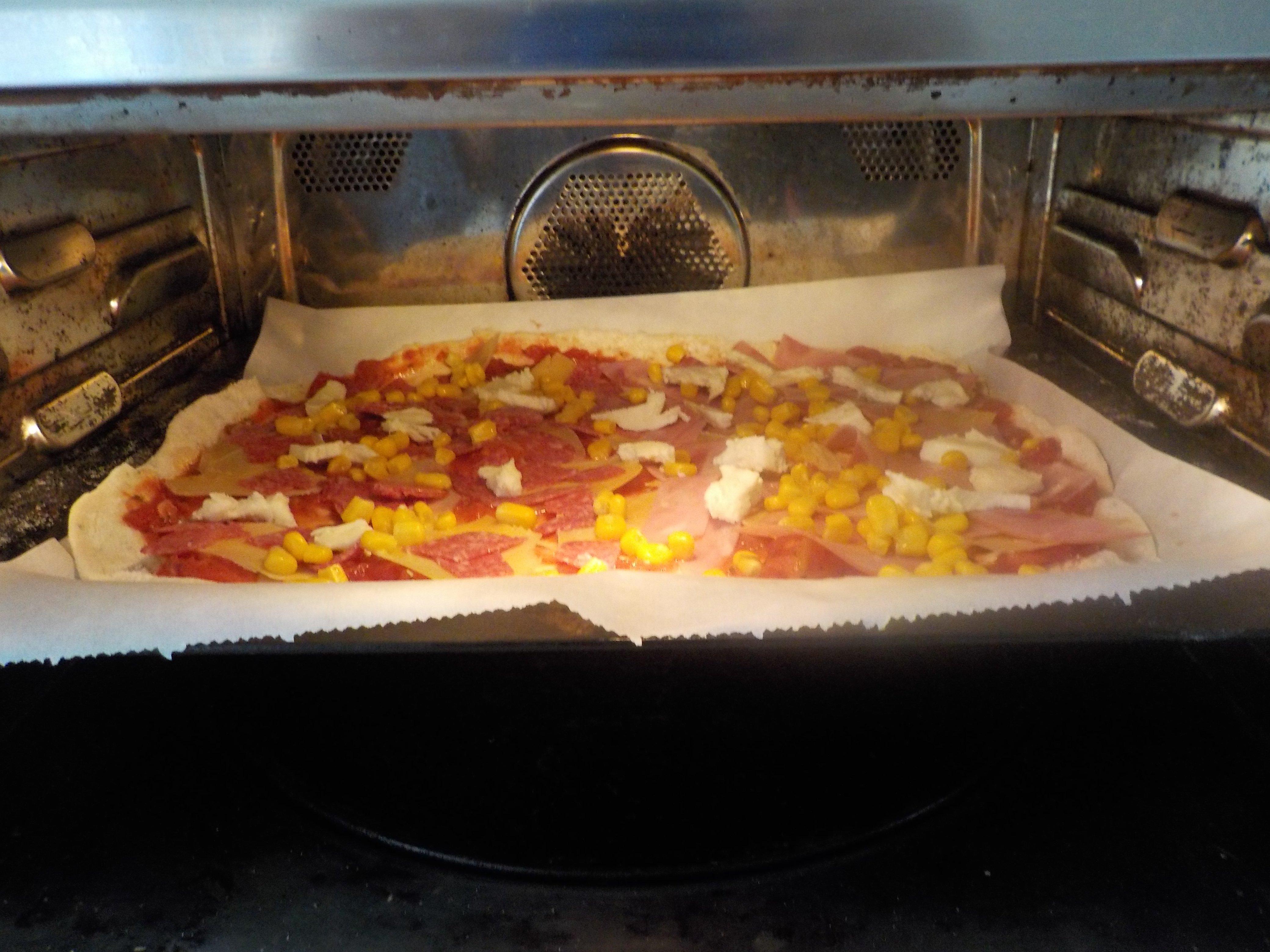 pizza hoe lang in de oven